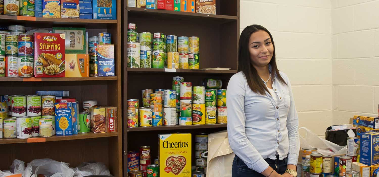 Amanda smiling in the food pantry on campus